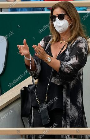 Mirka Federer wife of Switzerland's Roger Federer stands and applauds him after he defeated Croatia's Marin Cilic in their second round match on day 5, of the French Open tennis tournament at Roland Garros in Paris, France