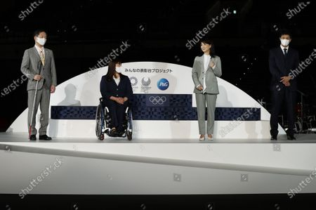 Stock Picture of Olympians and Paralympians (L-R) Junichi Kawai, Kuniko Obinata, Kyoko Iwasaki and Ryota Murata attend an unveiling event for the elements including podium, music, costume and medal tray that will be used during the victory ceremonies at the Tokyo 2020 Olympic and Paralympic Games at Ariake Arena, in Tokyo, Japan, 03 June 2021.