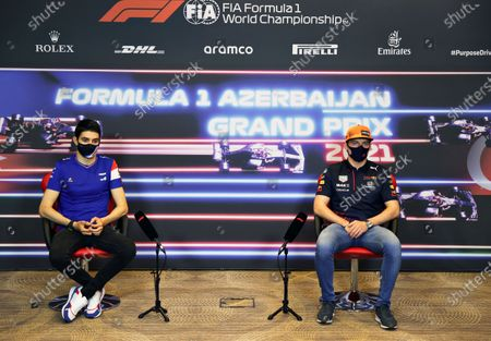 Alpine driver Esteban Ocon of France, left, and Red Bull driver Max Verstappen of the Netherlands participate in a media conference ahead of the Formula One Grand Prix at the Baku Formula One city circuit in Baku, Azerbaijan,. The Azerbaijan Formula One Grand Prix will take place on Sunday