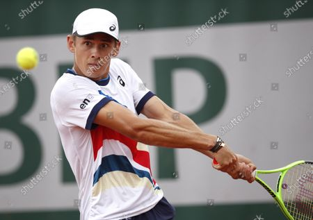 Alex de Minaur of Australia in action against Marco Cecchinato of Italy during their second round match at the French Open tennis tournament at Roland Garros in Paris, France, 03 June 2021.