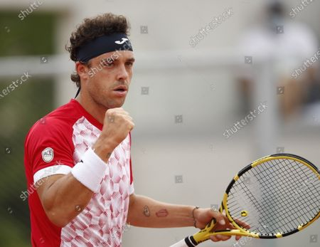 Marco Cecchinato of Italy in action against Alex de Minaur of Australia during their second round match at the French Open tennis tournament at Roland Garros in Paris, France, 03 June 2021.