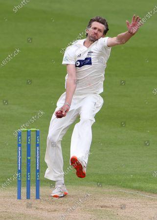 Michael Hogan of Glamorgan bowling.