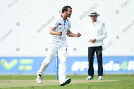 Alex Hughes of Derbyshire celebrates taking the wicket of Tim Bresnan of Warwickshire