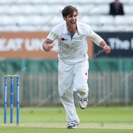 Michael Cohen of Derbyshire celebrates taking the wicket of Michael Burgess of Warwickshire