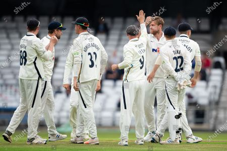 YorkshireÕs David Willey celebrates with Adam Lyth and team-mates after taking the wicket of SussexÕs Tom Haines.