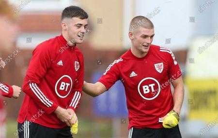 Lewis Collins, left, and Ryan Stirk during training session at Stebonheath Park, Llanelli, ahead of their UEFA U21 EURO 2023 qualifying round match against Moldova