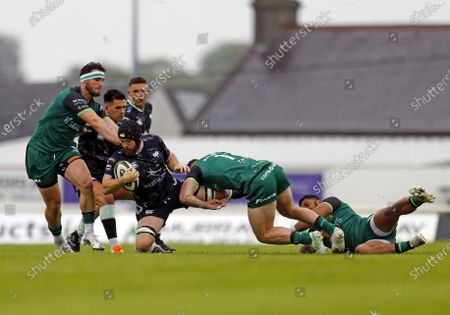 Tom Daly and Peter Sullivan (Connacht) stop Morgan Morris (Ospreys); Galway Sportsgrounds, Galway, Connacht, Ireland; Rainbow Cup Rugby, Connacht versus Ospreys.