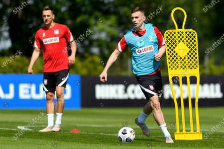 Polish national soccer team players Arkadiusz Milik (L) and Kacper Kozlowski (R) during a training session in Opalenica, Poland, 03 June 2021. Poland is preparing for the UEFA EURO 2020 tournament and will face Spain, Sweden and Slovakia in their Group E stage.