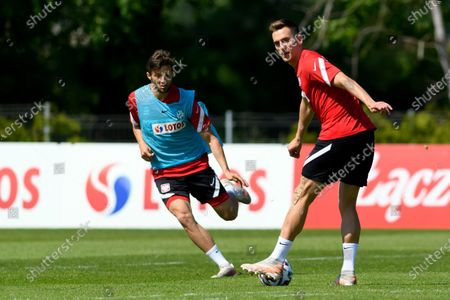 Polish national soccer team players Bartosz Bereszynski (L) and Arkadiusz Milik (R) during a training session in Opalenica, Poland, 03 June 2021. Poland is preparing for the UEFA EURO 2020 tournament and will face Spain, Sweden and Slovakia in their Group E stage.