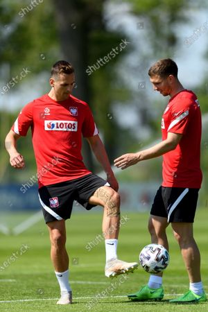 Polish national soccer team players Arkadiusz Milik (L) and Jakub Swierczok (R) during a training session in Opalenica, Poland, 03 June 2021. Poland is preparing for the UEFA EURO 2020 tournament and will face Spain, Sweden and Slovakia in their Group E stage.