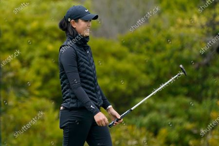 Michelle Wie West smiles after making a putt on the first green during the first round of the U.S. Women's Open golf tournament at The Olympic Club, in San Francisco