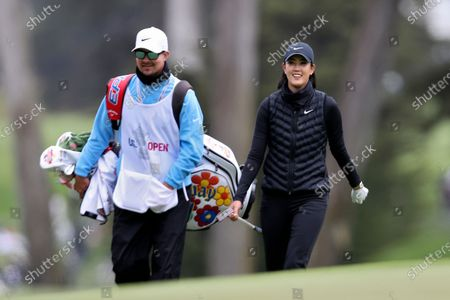 Michelle Wie West walks up the fourth fairway during the first round of the U.S. Women's Open golf tournament at The Olympic Club, in San Francisco
