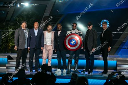 Anthony Mackie (second from left), Paul Rudd (third from left) along with California Adventure's Black Captain America and other Marvel executives gather on stage at the grand opening ceremony of Disney California Adventure's new Avengers Campus on Wednesday, June 2, 2021 in Anaheim, CA. (Jason Armond / Los Angeles Times)