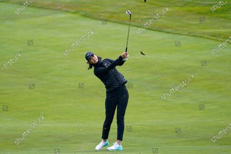 Michelle Wie West hits from the first fairway during the first round of the U.S. Women's Open golf tournament at The Olympic Club, in San Francisco