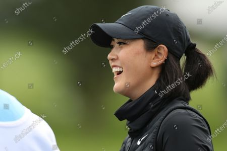 Michelle Wie West smiles on the sixth tee during the first round of the U.S. Women's Open golf tournament at The Olympic Club, in San Francisco