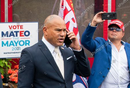 New York City mayoral candidate Fernando Mateo speaks on his mobile as he departs a campaign event where Michael Flynn, former national security adviser to former President Donald Trump, endorsed him, in Staten Island, N.Y