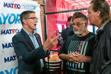 Michael Flynn, left, former national security adviser to former President Donald Trump, speaks with attendees at the end of a campaign event where he endorsed New York City mayoral candidate Fernando Mateo, in Staten Island, N.Y