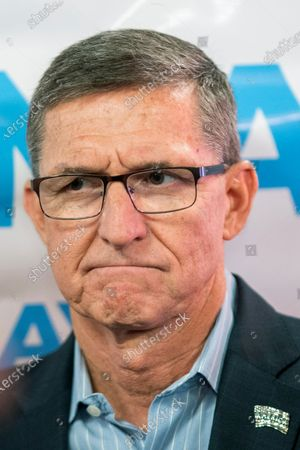 Michael Flynn, former national security adviser to former President Donald Trump, pauses while attending a campaign event where he endorsed New York City mayoral candidate Fernando Mateo during a campaign event, in Staten Island, N.Y