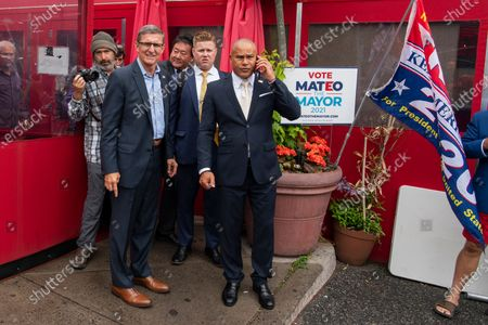Michael Flynn, second from left, former national security adviser to former President Donald Trump, and New York City mayoral candidate Fernando Mateo, right, depart a campaign event where Flynn endorsed Mateo, in Staten Island, N.Y