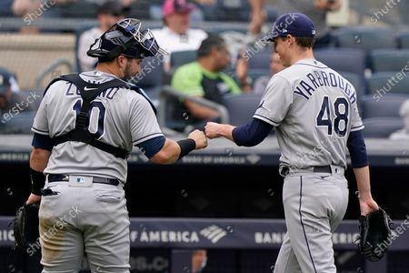 Tampa Bay Rays starting pitcher Ryan Yarbrough (48) bumps fists with Rays catcher Mike Zunino (10) after the sixth inning of a baseball game against the New York Yankees, at Yankee Stadium in New York