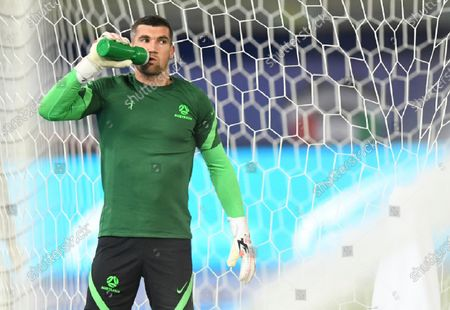 Australia's goalkeeper Mathew Ryan drinks water as warms up ahead of the World Cup 2022 Group B qualifying soccer match between Kuwait and Australia in Kuwait City, Kuwait