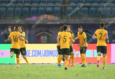 Stock Image of Australia players celebrate after their teammate Mathew Leckie scores his side's opening goal during the World Cup 2022 Group B qualifying soccer match between Kuwait and Australia in Kuwait City, Kuwait