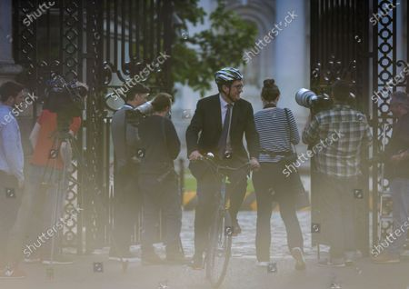 Eamon Ryan (C), Ireland's Minister for Environment, Climate and Communications, leaves the government buildings on his bicycle, with the media representatives at the gate waiting for DUP leader Edwin Poots after meeting Taoiseach Michael Martin.On Thursday, 3 June, 2021, in Dublin, Ireland.