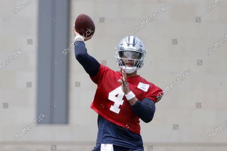 Dallas Cowboys quarterback Dak Prescott (4) throws during NFL football practice in Frisco, Texas