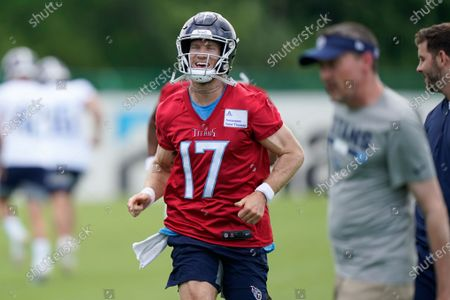 Tennessee Titans quarterback Ryan Tannehill warms up during NFL football practice, in Nashville, Tenn