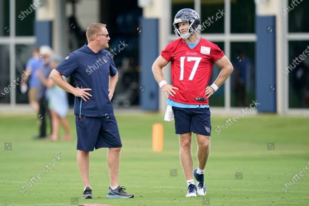 Tennessee Titans quarterback Ryan Tannehill (17) talks with offensive coordinator Todd Downing during NFL football practice, in Nashville, Tenn