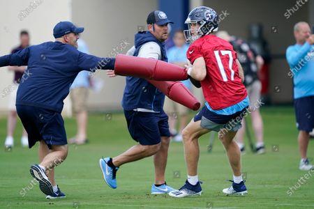 Tennessee Titans quarterback Ryan Tannehill (17) runs a drill during an NFL football practice, in Nashville, Tenn