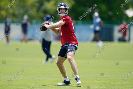 Tennessee Titans quarterback Ryan Tannehill throws during an NFL football practice, in Nashville, Tenn