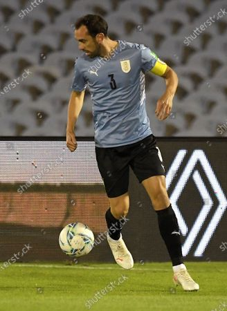 Stock Image of Uruguay's Diego Godin in action against Paraguay, during the South American Qualifying for the Qatar 2022 World Cup soccer match between Uruguay and Paraguay at Centenario stadium in Montevideo, Uruguay, 03 June 2021.
