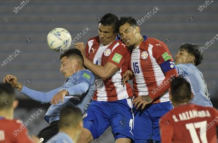 Stock Image of Uruguay's Jose Maria Gimenez, left, Paraguay's Fabian Balbuena, center, and Gustavo Gomez battle for the ball during a World Cup qualifying soccer match in Montevideo, Uruguay