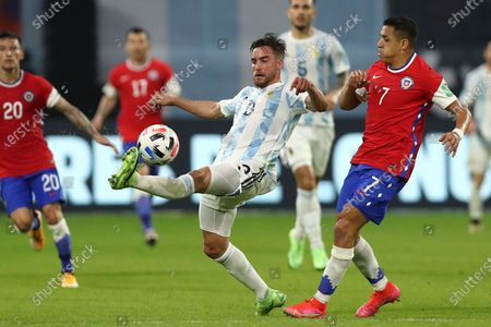 Argentina's Nicolas Tagliafico, left, and Chile's Alexis Sanchez battle for the ball during a qualifying soccer match for the FIFA World Cup Qatar 2022 in Santiago del Estero, Argentina