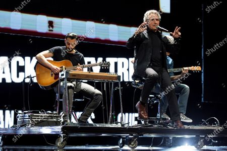 Spanish rock singer Miguel Rios (R) performs on stage during the Malaga's Cinema Festival openning gala at Cervantes Theatre in Malaga, southern Spain, 03 June 2021.