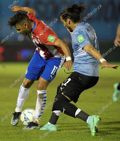 Stock Image of Martin Caceres (R) of Uruguay in action against Angel Romero (L) of Paraguay during the South American Qatar World Cup 2022 qualifier match soccer match between Uruguay and Paraguay at the Centenario Stadium in Montevideo, Uruguay, 03 June 2021.
