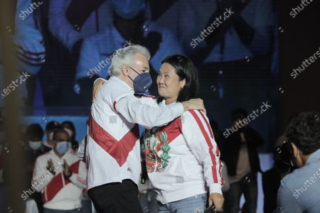 The candidate for the Presidency of Peru Keiko Fujimori (R), from the Fuerza Popular party, hugs Alvaro Vargas Llosa (L), son of the Nobel Prize winner Mario Vargas Llosa, during an event marking the closure of her campaign ahead of the second round of presidential elections, at the Las Palomas oval in the Villa El Salvador district in Lima, Peru, 03 June 2021. On 06 June, Keiko will face Pedro Castillo of the Peru Libre party, with whom she waged a tense political campaign, intensified in recent weeks. In the second presidential round, more than 25 million Peruvians are summoned to the polls to elect the person who will govern Peru for the next five years.