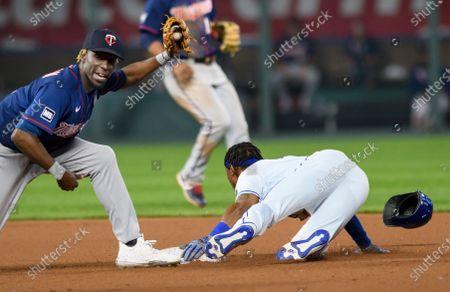 Kansas City Royals' Jarrod Dyson steals second base past Minnesota Twins second baseman Nick Gordon during the seventh inning of a baseball game, in Kansas City, Mo