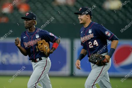 Minnesota Twins second baseman Nick Gordon, left, and right fielder Trevor Larnach head to the dugout at the end of the sixth inning of a baseball game against the Baltimore Orioles, in Baltimore