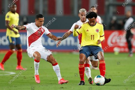 Yoshimar Yotun (L) of Peru vies for the ball with Juan Guillermo Cuadrado (R-Front) of Colombia during the South American Qatar World Cup 2022 qualifiers soccer match between Colombia and Peru at the Nacional Stadium in Lima, Peru, 03 June 2021.