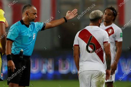 Peru's Miguel Trauco (R) is sent off by Brazilian referee Wilton Sampaio (L), during the South American Qatar World Cup 2022 qualifiers soccer match between Colombia and Peru at the Nacional Stadium in Lima, Peru, 03 June 2021.