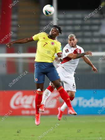 Miguel Trauco (R) of Peru in action against Duvan Zapata of Colombia during the South American Qatar World Cup 2022 qualifiers soccer match between Colombia and Peru at the Nacional Stadium in Lima, Peru, 03 June 2021.