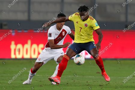 Peru's Yoshimar Yotun (L) in action against Colombia's Duvan Zapata (R) during the South American Qatar World Cup 2022 qualifiers soccer match between Colombia and Peru at the Nacional Stadium in Lima, Peru, 03 June 2021.
