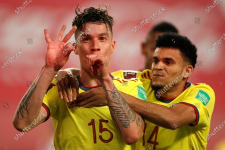 Colombia's Mateus Uribe (L) celebrates with his teammate Luis Diaz (R) after scoring against Peru, during the South American Qatar World Cup 2022 qualifiers soccer match between Colombia and Peru at the Nacional Stadium in Lima, Peru, 03 June 2021.