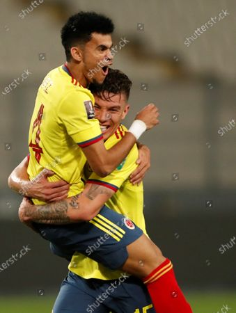 Colombia's Luis Diaz (L) celebrates with his teammate Mateus Uribe (R) after scoring against Peru, during the South American Qatar World Cup 2022 qualifiers soccer match between Colombia and Peru at the Nacional Stadium in Lima, Peru, 03 June 2021.