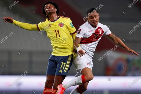 Yoshimar Yotun (R) of Peru in action against Juan Guillermo Cuadrado (L) of Colombia during the South American Qatar World Cup 2022 qualifiers soccer match between Colombia and Peru at the Nacional Stadium in Lima, Peru, 03 June 2021.