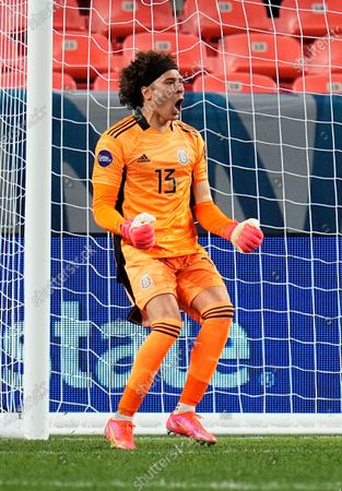 Stock Picture of Mexico's Guillermo Ochoa celebrates the team's win on penalty kicks against Costa Rica during a CONCACAF Nations League soccer semifinal, in Denver