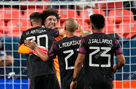 Mexico's Guillermo Ochoa, facing camera, and teammates celebrate a win against Costa Rica on penalty kicks during a CONCACAF Nations League soccer semifinal, in Denver