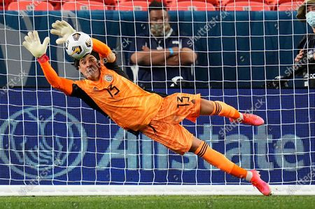 Mexico's Guillermo Ochoa makes a save to win on penalty kicks against Costa Rica during a CONCACAF Nations League soccer semifinal, in Denver